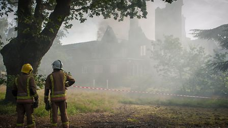 Fire fighters at Pinebanks tackling the blaze which broke out in the early hours. Photo: Bill Smith