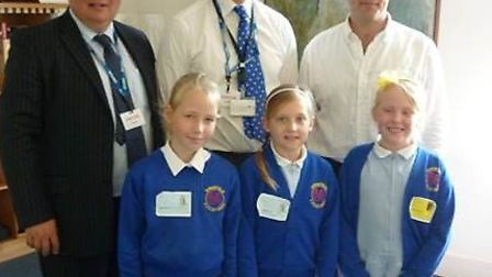Ringsfield pupils Harriet, Grace and Jasmine with leader of Suffolk County Council Mark Bee, Waveney