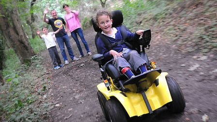 Edith Creasy, 6, in her new buggy. Pictured with her mum and dad Ruth and Sean and her brother Adam,