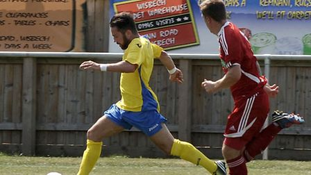 Action from Wisbech Town, red, and King's Lynn Town's pre-season friendly last summer. Picture: Stev