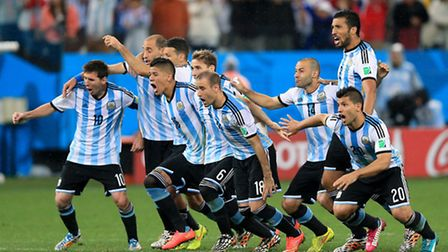 Argentina players celebrate victory in the penalty shoot-out during the FIFA World Cup Semi Final at