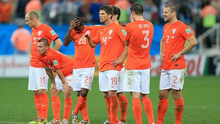 Netherlands players appear dejected in the penalty shoot-out during the FIFA World Cup Semi Final at
