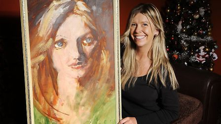 Cathy Sims with her Rolf Harris painting, after it was valued at £50,000. Picture: Ian Burt