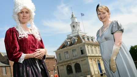 From left, Liz Kuczora and Janet North in period dress in front of the Custom House in King's Lynn,