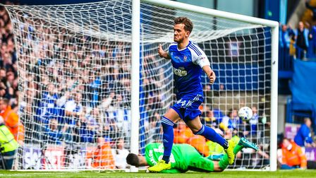 Emyr Huws wheels away after scoring Town's third in the 3-1 win over Newcastle in the Ipswich Town v