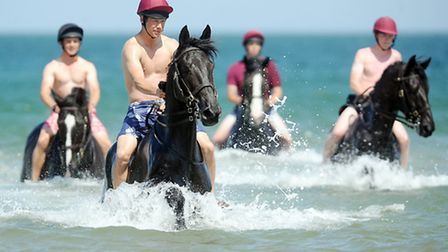 The Household Cavalry on their annual visit to Holkham Beach. Picture: Matthew Usher.