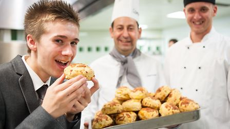 16-year-old Lee Sutton tries the scones made by Richard Marks in the John Lewis kitchens with David
