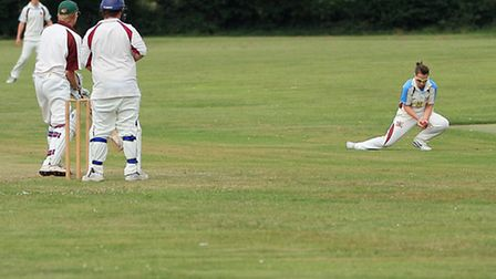 Fakenham's Emily Woodhouse taking a catch in their West Norfolk Division Three match against Snetti