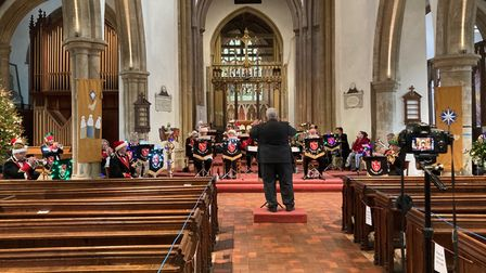 Town band playing in a church at Christmas