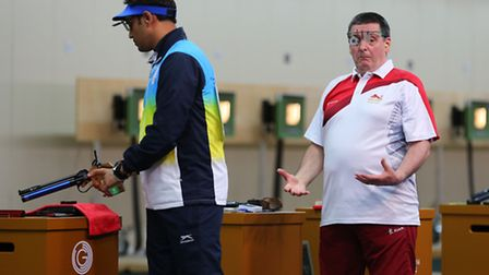 England's Michael Gault reacts to a shot during the final of the 10m Air Pistol Men at the Barry Bud