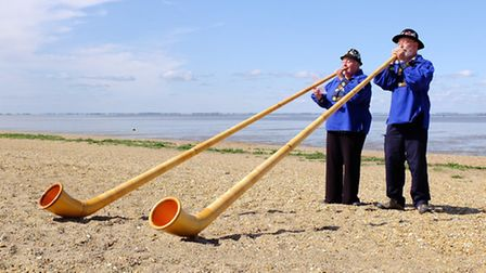 Alphorn players Helen and Neil Grundy blow their 10ft instruments at Snettisham in celebration, afte
