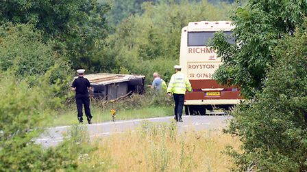 Police examine the overturned coach at Hilgay. Picture: Matthew Usher.