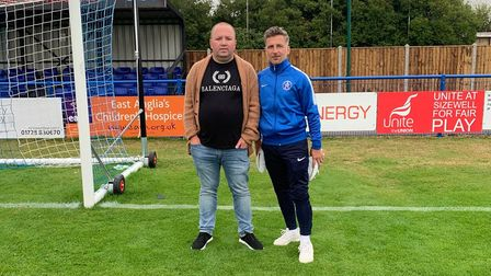 Footballer Darren Eadie with man on pitch in front of goal