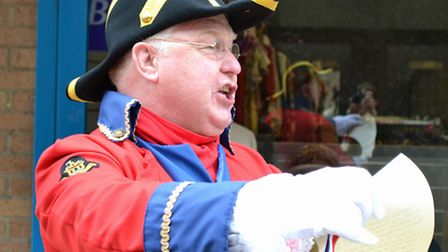 Mike Wabe, Thetford's Town Crier, at the opening of the new St Nicholas Hospice Care shop in the tow