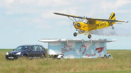 Brendan O'Brien breaks the world record and lands his aircraft on the back of a moving trailer at th
