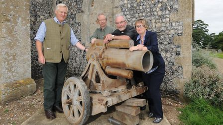 WWI mortar returned to Honing church. Left to right, Major General Sir William Cubitt, Dr Geoffrey C