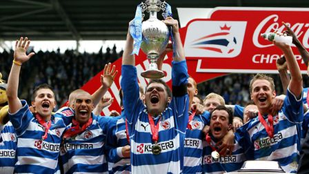 Graeme Murty, pictured lifting the Coca Cola Championship League trophy with Reading in 2006, has jo