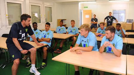 Changes at NCFC training ground at Colney. Dmitri Halajko with the Academy players in the classroom.