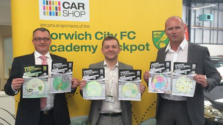 Left to righ, John Ruskin, retail manager CarShop Norwich. and Bernie Whelan and Stephen Hobin, sale