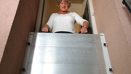 Louise Goodison with her new flood barrier to protect her home on Blakeney Quay.Picture: ANTONY KELL