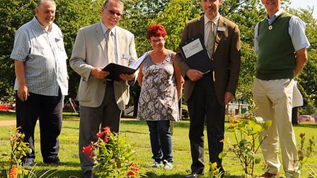 Britain in Bloom judges, Andrew Jackson, 2nd right, and Mel Henley, 2nd left, at the Jenny Lind Park
