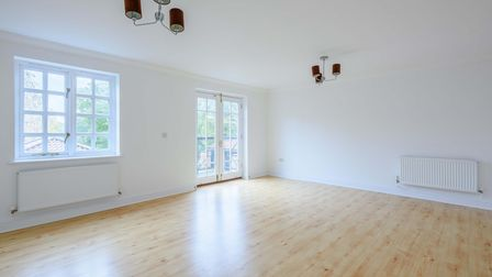 White reception room with wood effect flooring