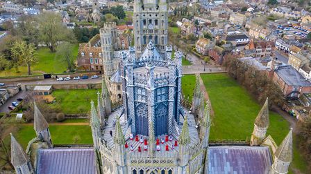 The girls choir from Ely Cathedral enjoying an outside rehearsal on the Octagon roof in preparation