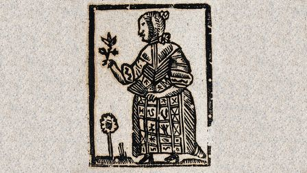 A wise woman holds a plant in one hand and a fan in the other. Woodcut from 1700-1720