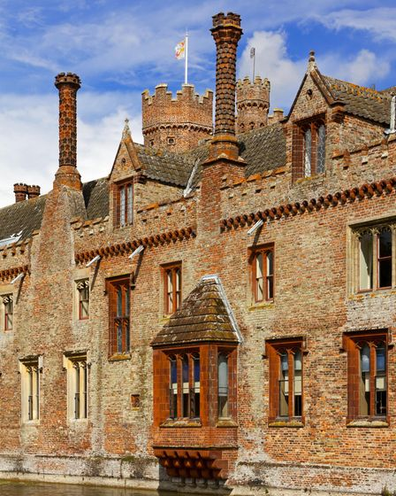 Detail of brickwork and chimneys on the west range at Oxburgh Hall, Norfolk. The projecting ground-f