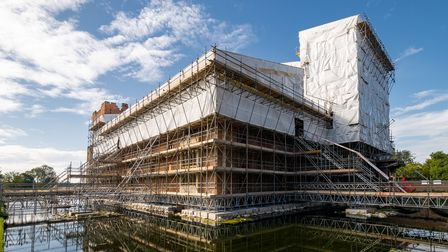 Oxburgh Hall surrounded in scaffolding.