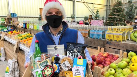 Sam Steggles with a Christmas hampers of seasonal local food at his farm shop at Fielding Cottage in Honingham