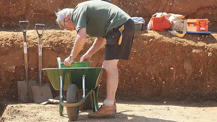 An archaeologist sifts through material. Picture: Ian Burt