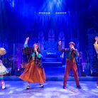 Four actors from The Snow Queen singing in a line