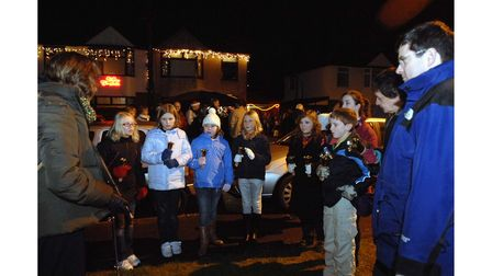 The 2nd Martlesham Heath Guides and Rangers bell ringing at the Deben AvenueChristmas street party in 2008