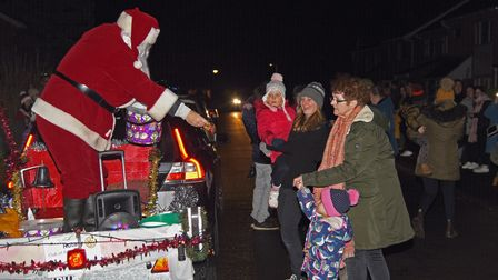 Santa, who is being escorted by Fakenham Rotary Club, greeting families on North Park in Fakenham. P