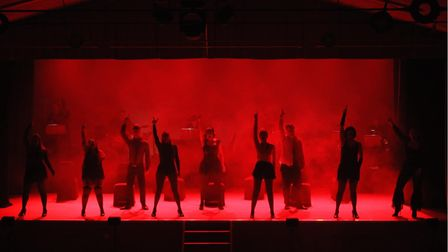 The cast preform a number from Chicago