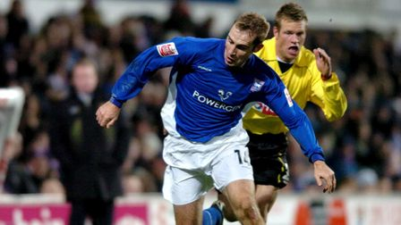 Ipswich Town's James Scowcroft (left) holds off Watford's Jay Demerit from the ball.