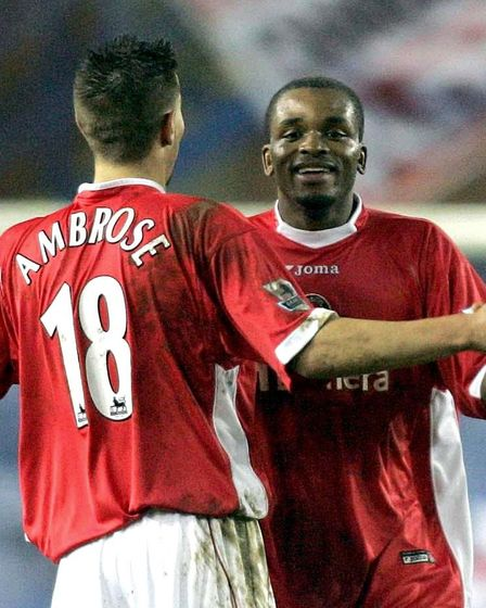 Charlton Athletic's Darren Bent (R) celebrates with team-mate Darren Ambrose after scoring the 4th g