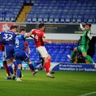 Oli Hawkins heads Town into a 1-0 lead against Crewe Picture: STEVE WALLER