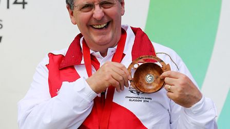 Dereham shooter Mick Gault with his bronze medal from the 10m Air Pistol event at the Glasgow 2014 C