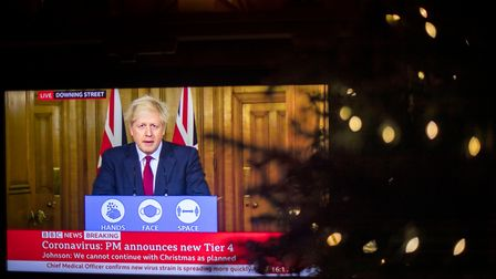 Prime Minister Boris Johnson on the television during a media briefing in Downing Street,