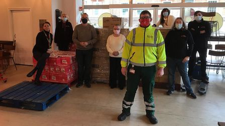 Barking and Dagenham Council staff standing with boxes of items to be packed into hampers