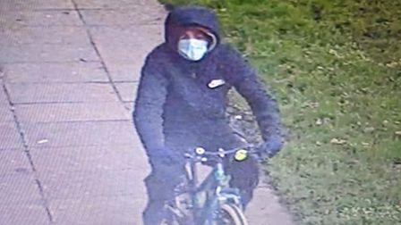 CCTV pictures of the suspect wanted afteranEly café owner's bike was stolen in broad daylight at around midday on...