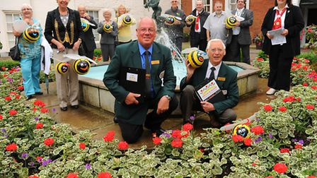 The Anglia in Bloom judges Brian Thornton, front right, and David White, front left, study the flora