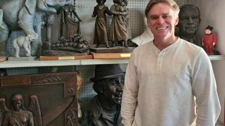 Suffolk sculptor Sean Hedges-Quinn with some of his work