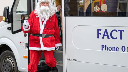FACT Community Transport roped in Santa, his elves and Rudolph to deliver the hampers.