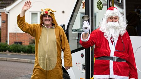 FACT Community Transport roped in Santa and Rudolph to deliver the hampers.