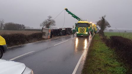 Recovery crews are clearing the A134 after a lorry overturned in an accident