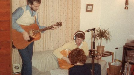 Tim Jefferson (seated) playing music at home.