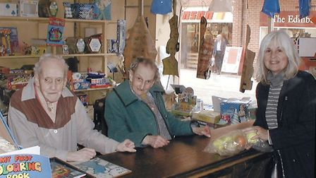Thelma Bond, centre, and Cynthia Bond, right, with Mrs Harmer, the last customer at their toy shop in Dereham High Street...